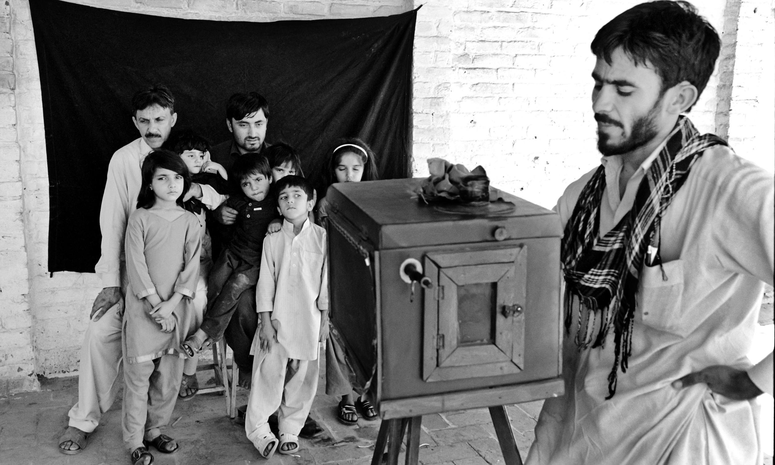 Izzat Ullah making a family photograph, Peshawar, 2012.