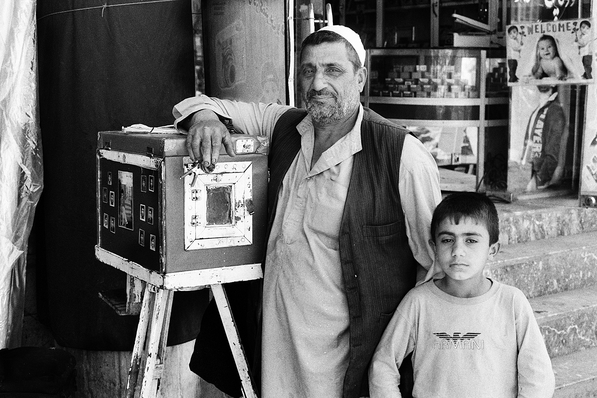 Roh Ullah, a Box Camera photographer with son. Kabul, 2011.