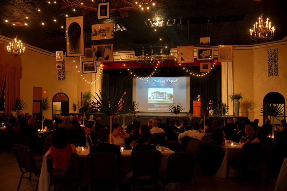The Greenville Arts Council used its Gallery System ArtsUp Award art display equipment to hang art from the ceiling at its recent dinner to celebrate the 100th anniversary of its E.E. Bass Cultural Arts Center facility. Photo by  Charles Sullivan .