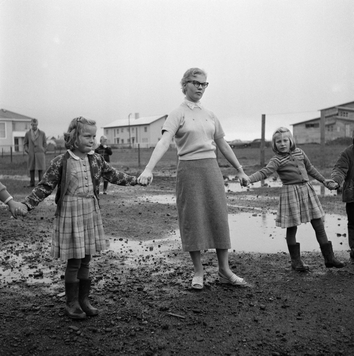 Gunnar Rúnar Ólafsson (1917-1965) Children and teacher at play in Selfoss, south Iceland, c. 1960.