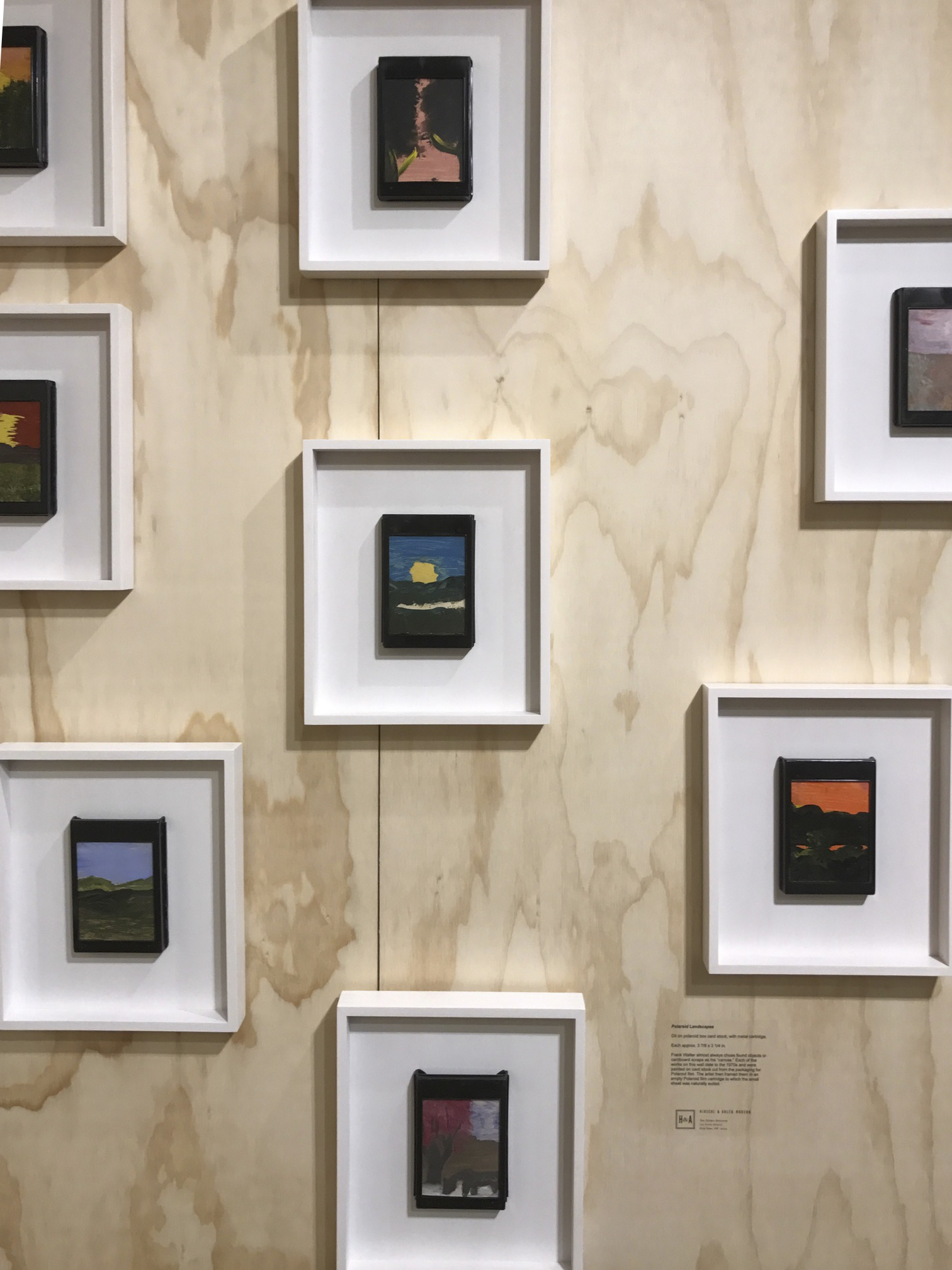 Frank Walter paintings on discarded Poloroid cartridges. Photo by the author.