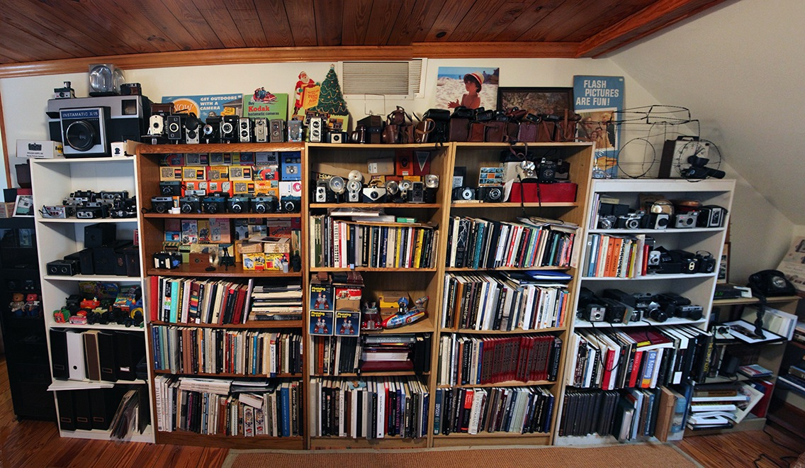 Tom Moore's camera collection and photo book library.
