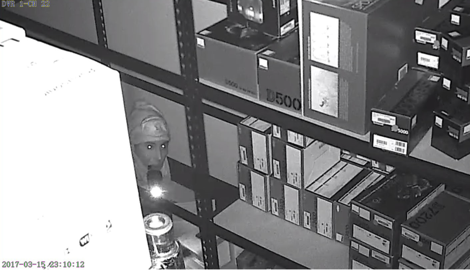Surveillance frames from Midwest Photo