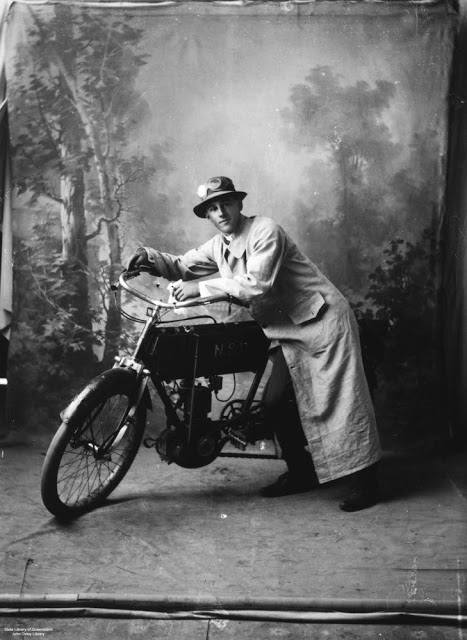A motorcyclist with his bike, Queensland, Australia, c. 1935
