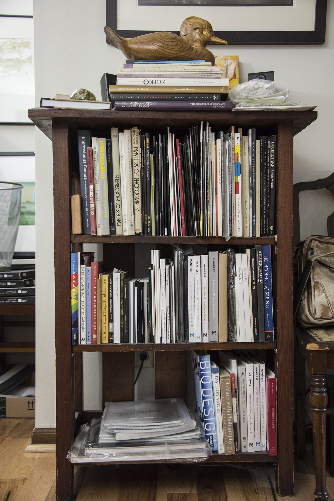 Kent Krugh 's mallard-topped photobook library.