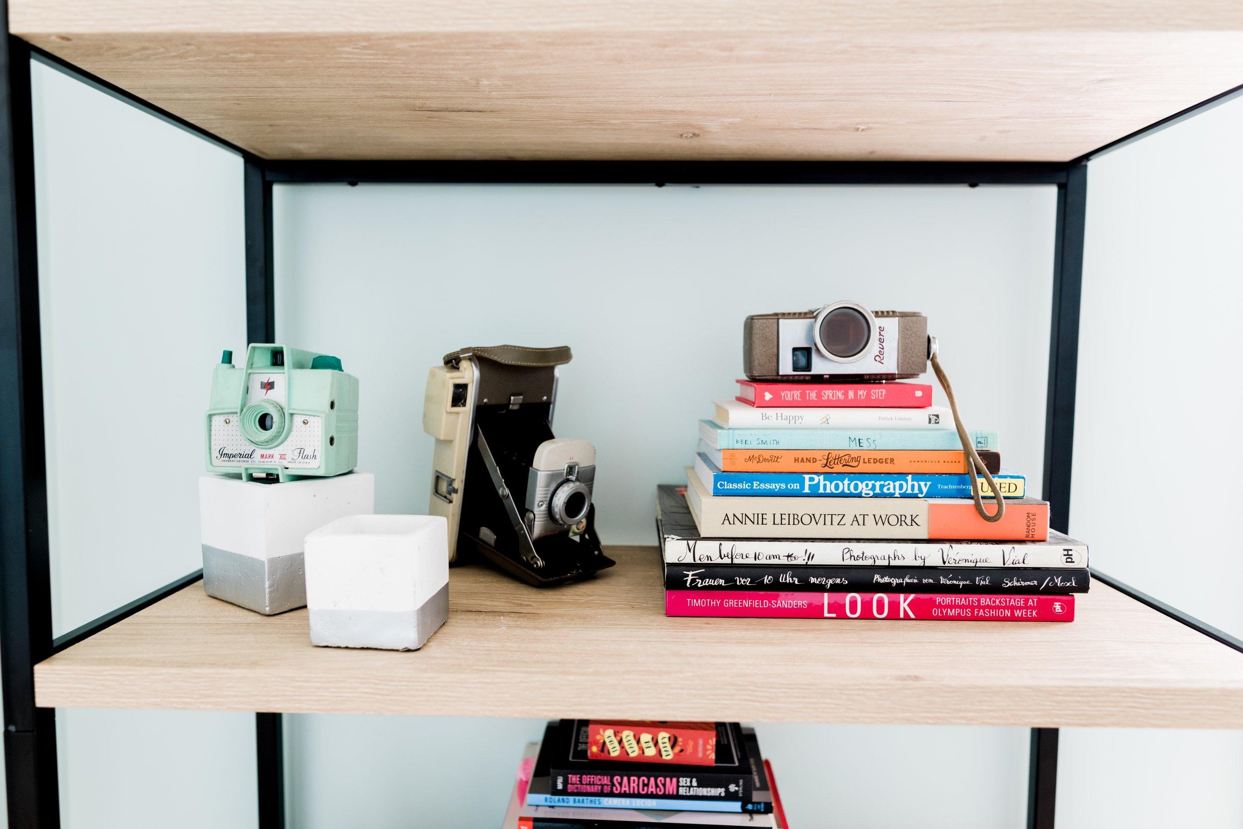 Kayla Sue 's bright and cheery photobook shelf.