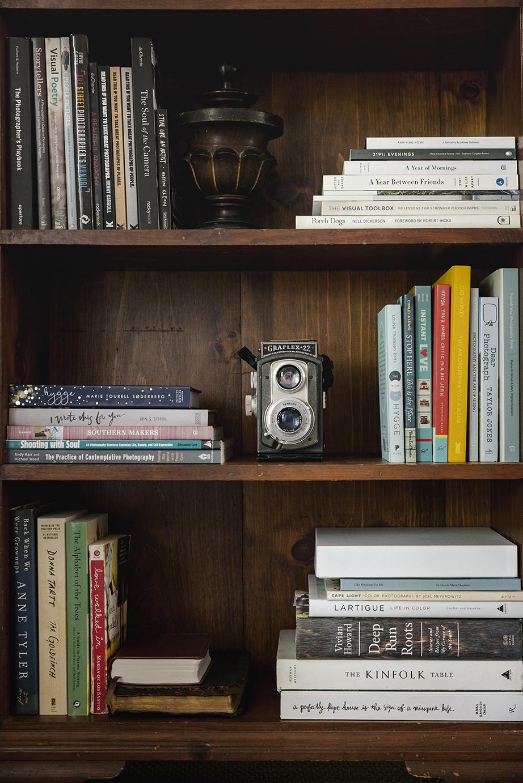 Art and literature on  Donna Hopkins ' bookshelves.