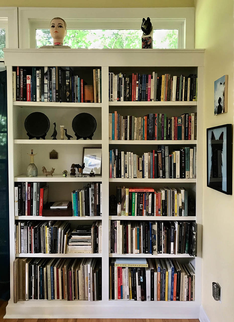 Constance Thalken 's built-in bookcase of photobooks.