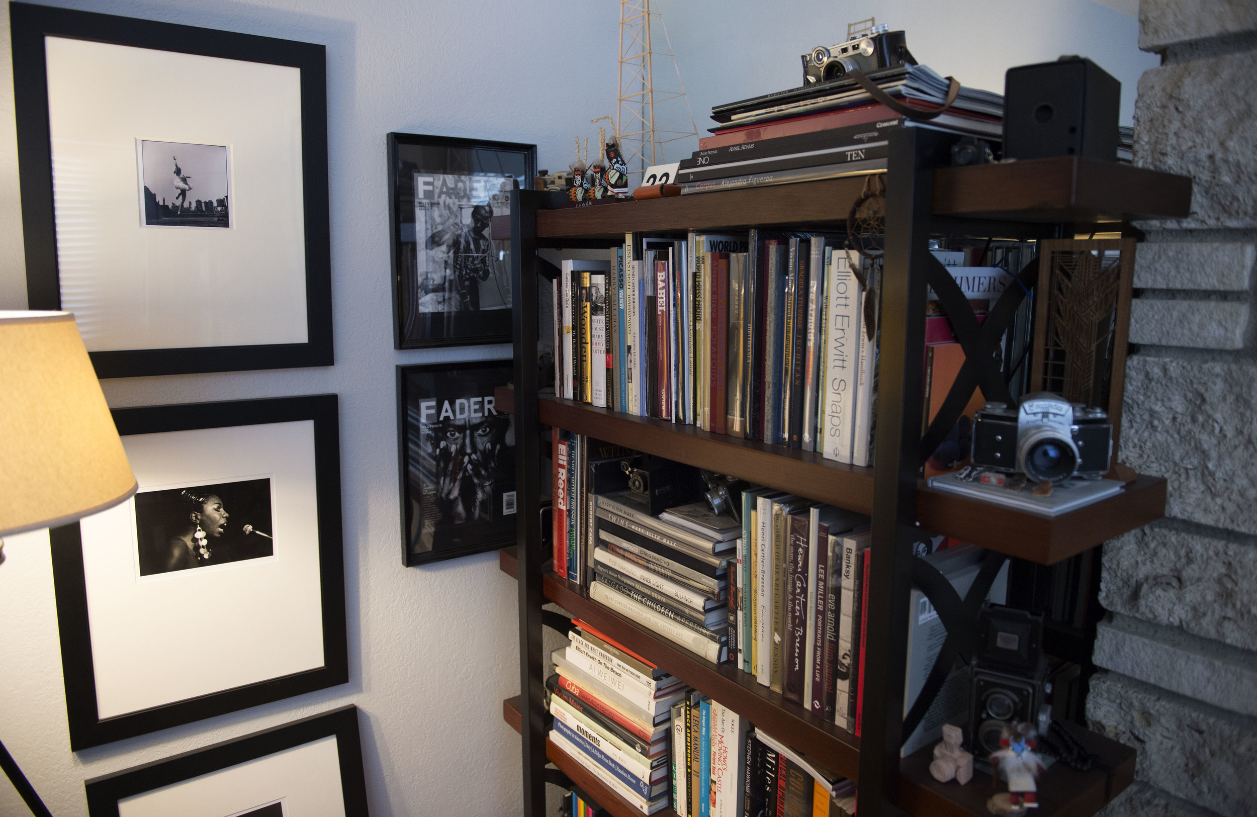 Rex Atienza 's photobook library surrounded by his favorite prints.