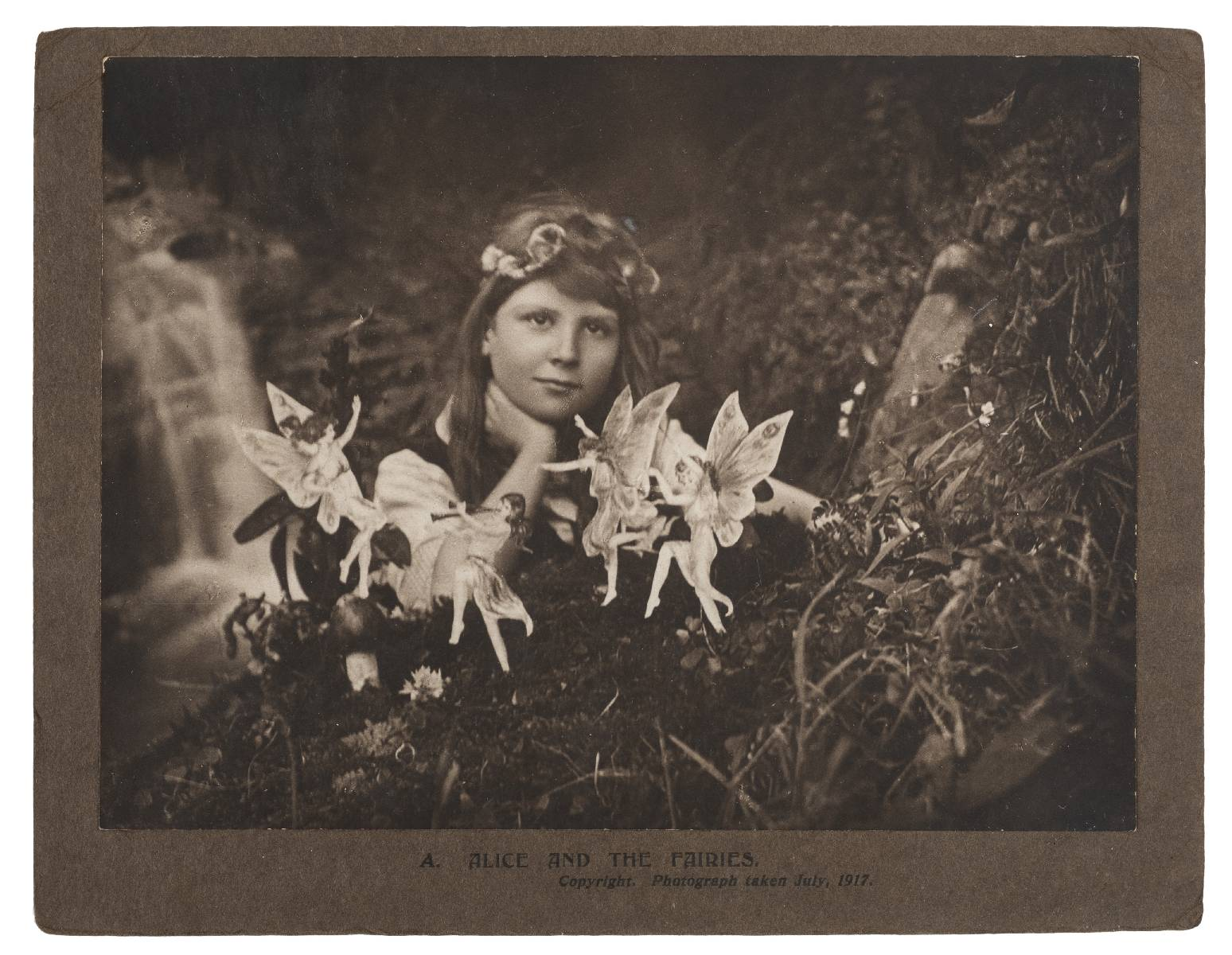 Alice and the Fairies,  photograph of Frances 'Alice' Griffiths, (1907-1986), by Elsie Wright (1901-1988), July, 1917 via Dominic Winter Auctioneers