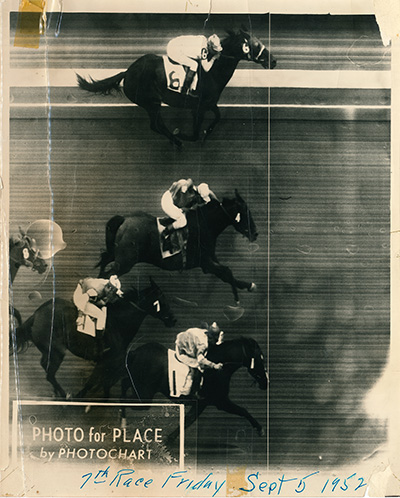 "The horse at the top ""wins by a nose"" (across the white vertical line) in a photo finish race during the 1952 State Fair. (Oregon State Archives, Oregon Fair Exposition Center)"