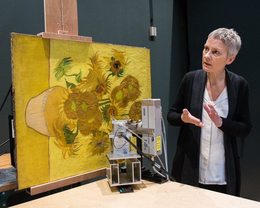 Conservator Ella Hendriks looks at Vincent van Gogh's  Sunflowers  (1889). Courtesy Van Gogh Museum © Maartje Strijbis.