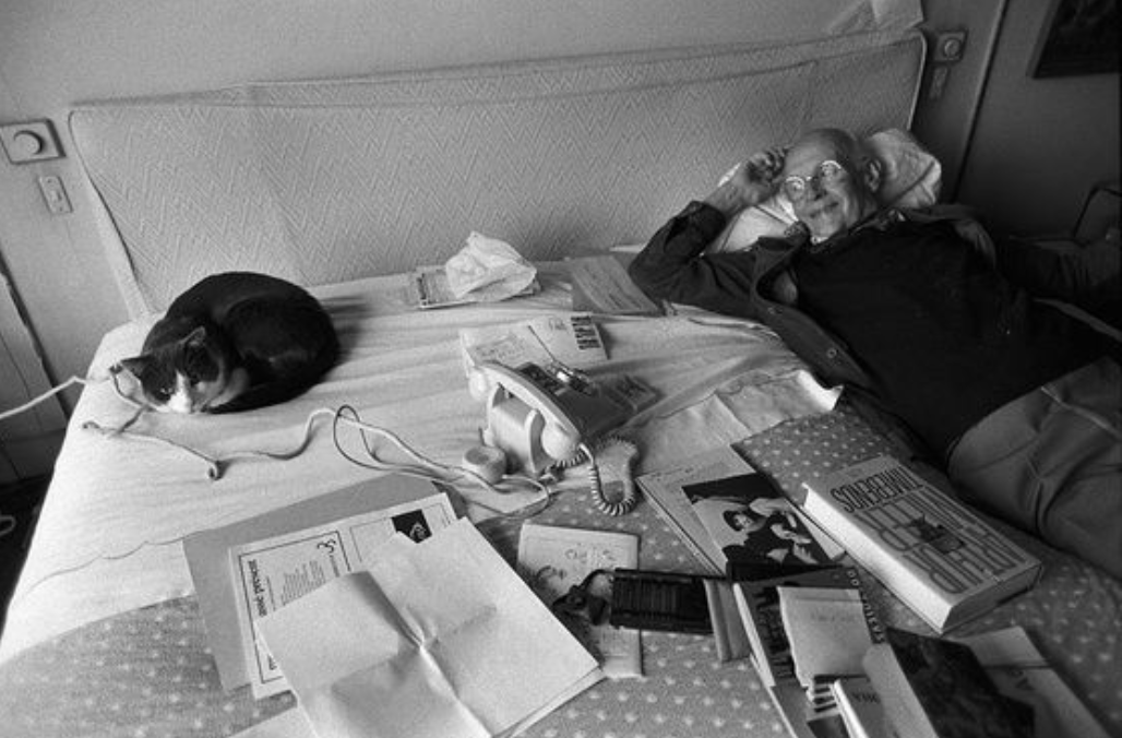 Henri Cartier-Bresson and his cat.