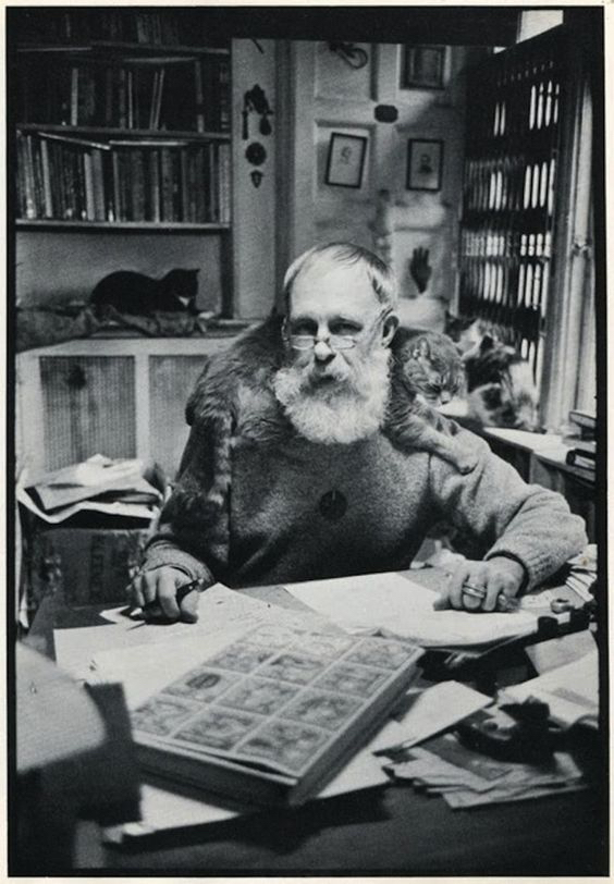 Edward Gorey with his cat in his studio.