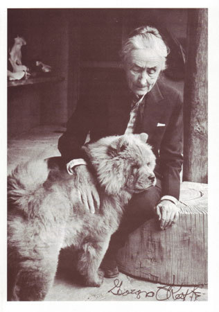 Postcard of Georgia O'Keeffe and one of her chows.