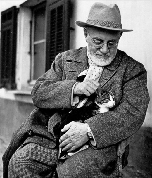 Henri Matisse enjoying an afternoon break from painting with his cat, Minouche, at his apartment and studio in Nice    (THE GREAT CAT)