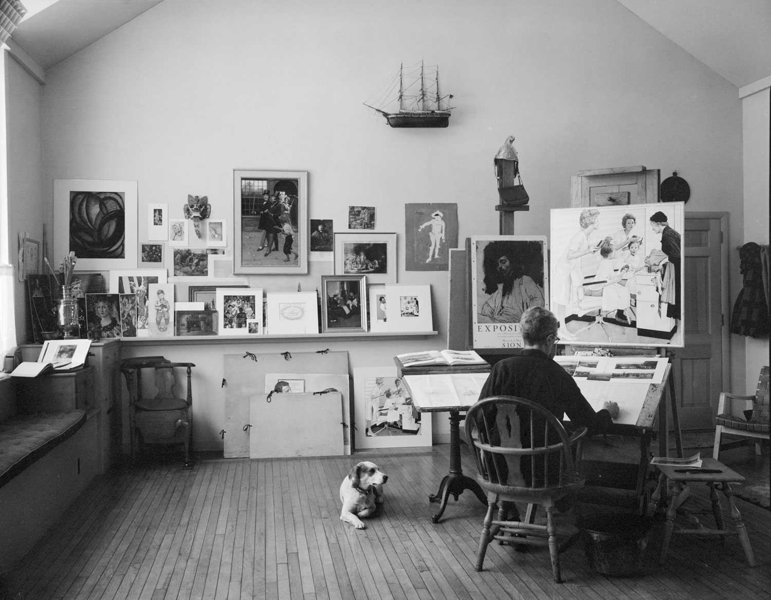 Rockwell in his studio. Photo courtesy of Norman Rockwell Museum