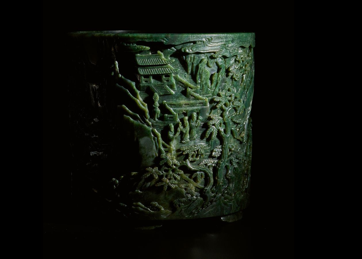 A finely carved large spinach-Ggeen jade 'immortals' brush pot from Qianlong period will lead Sotheby's Asia Week sale in September. Courtesy of Sotheby's