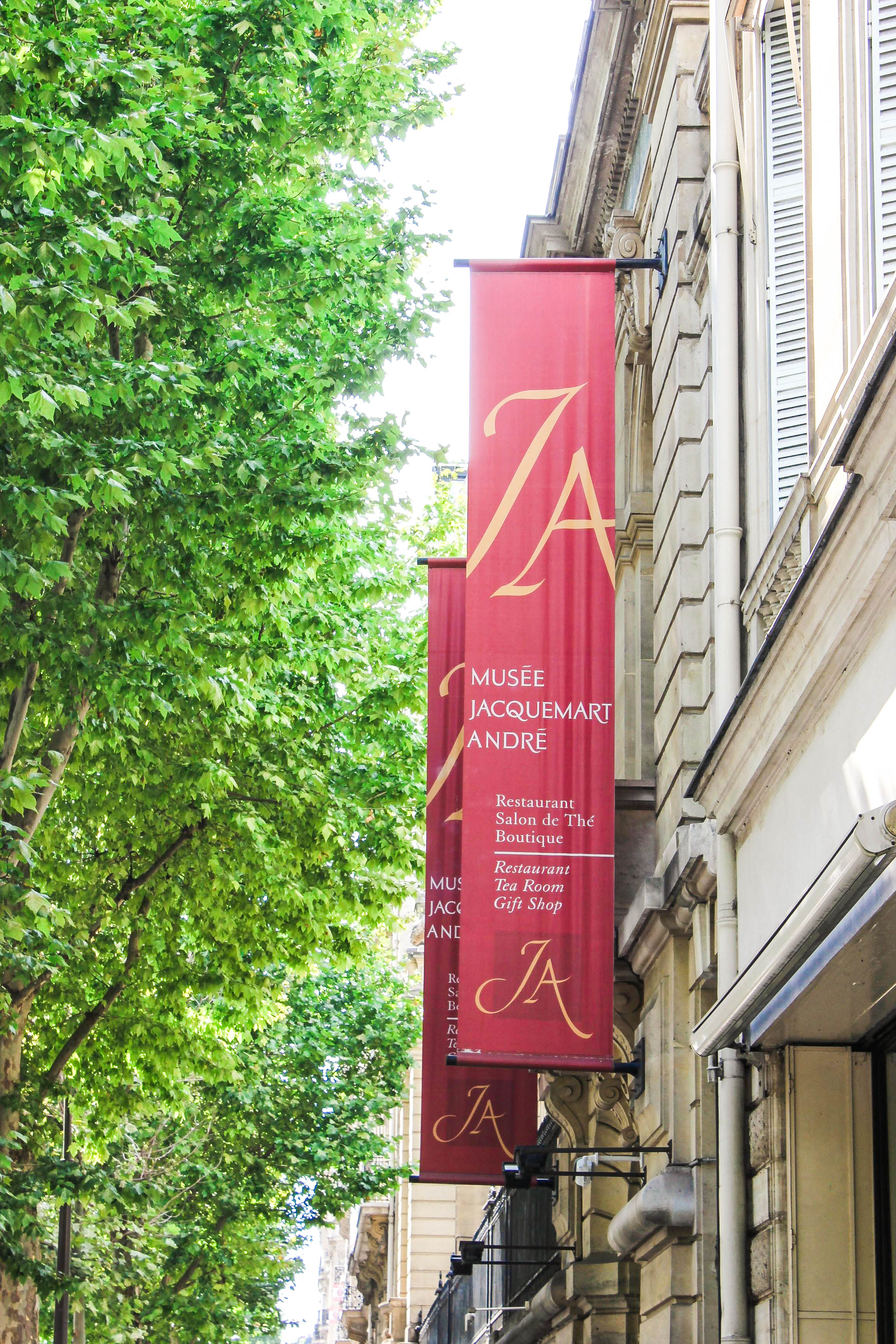 a small red banner of the museum