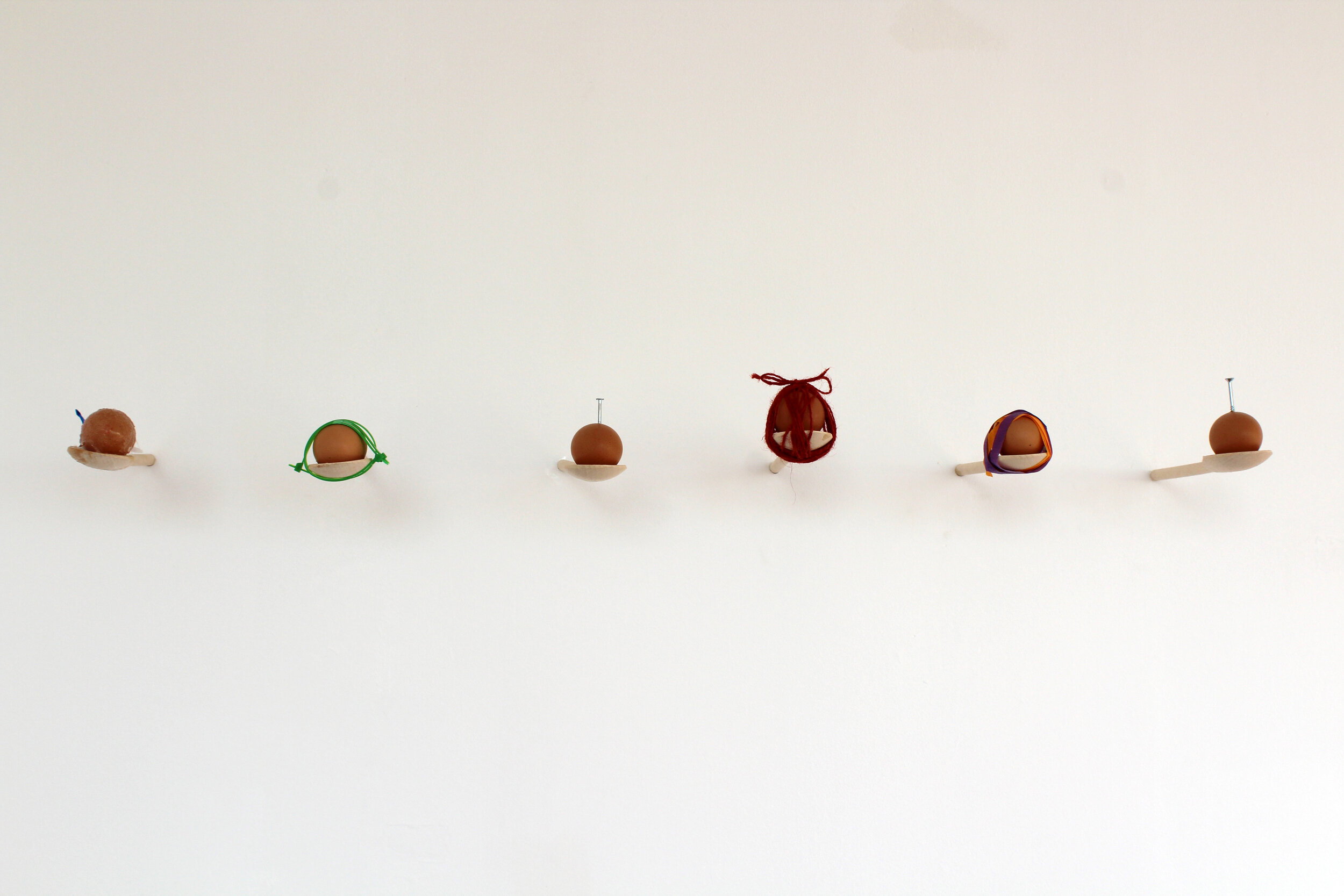 Emily Scarrott  Good Mom  (2019) Wooden spoons, eggshells and other objects 100 x 28 x 150 cm