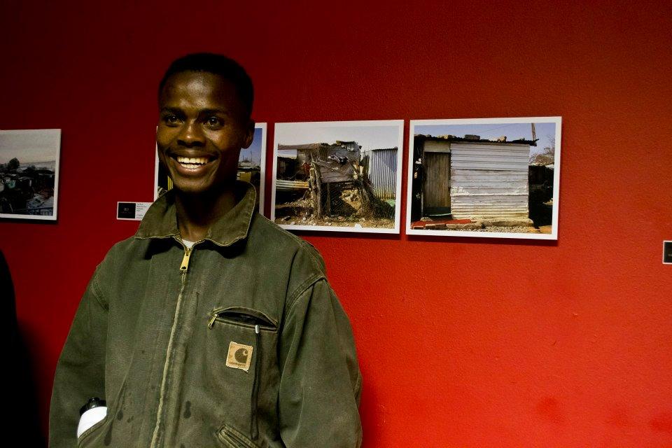 thulani and his photos.jpg