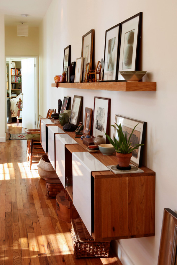 Remember you aren't limited to the traditional nail in wall. Try simply leaning frames or art against the wall, shelves, cabinets, or even the floor