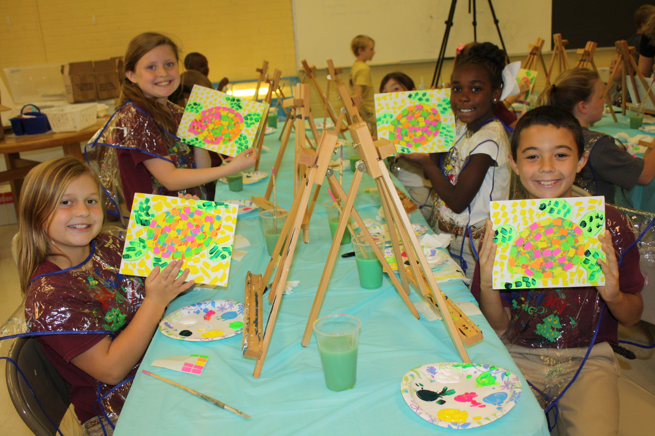 Students at Chatom Elementary showcase their masterpieces midway through the class.