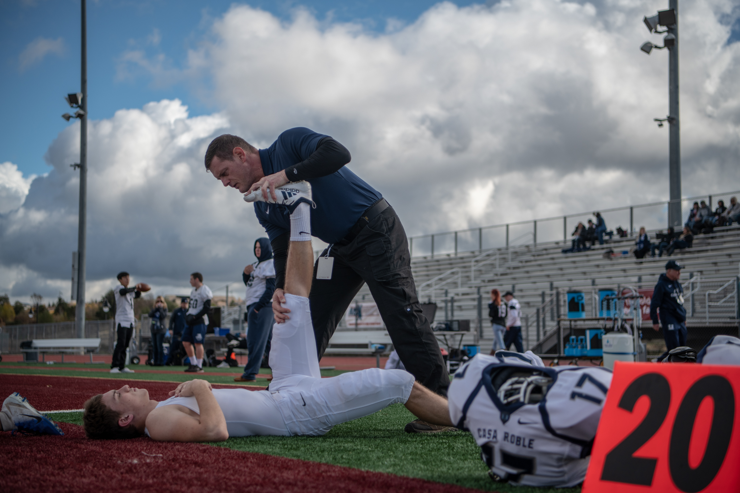Getting Ryan stretched before the game. Photo by  @s.kip