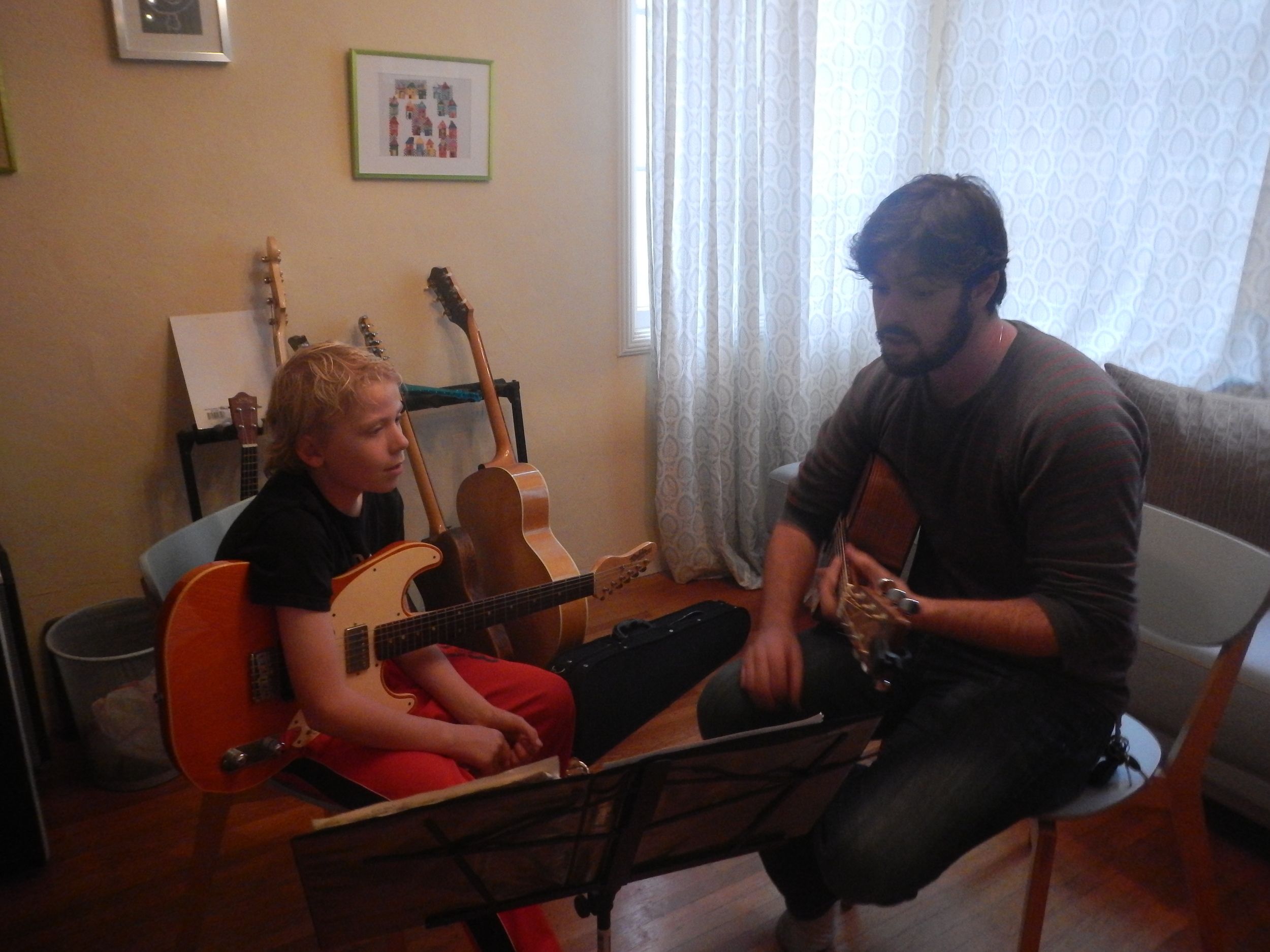 """""""Rory has been teaching my 8 year old son Oliver guitar for quite some time. Rory's teaching style is gentle, clear and fun. Oliver looks forward to his lessons every week and is making great progress in learning his instrument. Also for you parents, Rory is prompt, organized, professional and super convenient (he makes house calls!)."""" ---  Tom Heinz"""