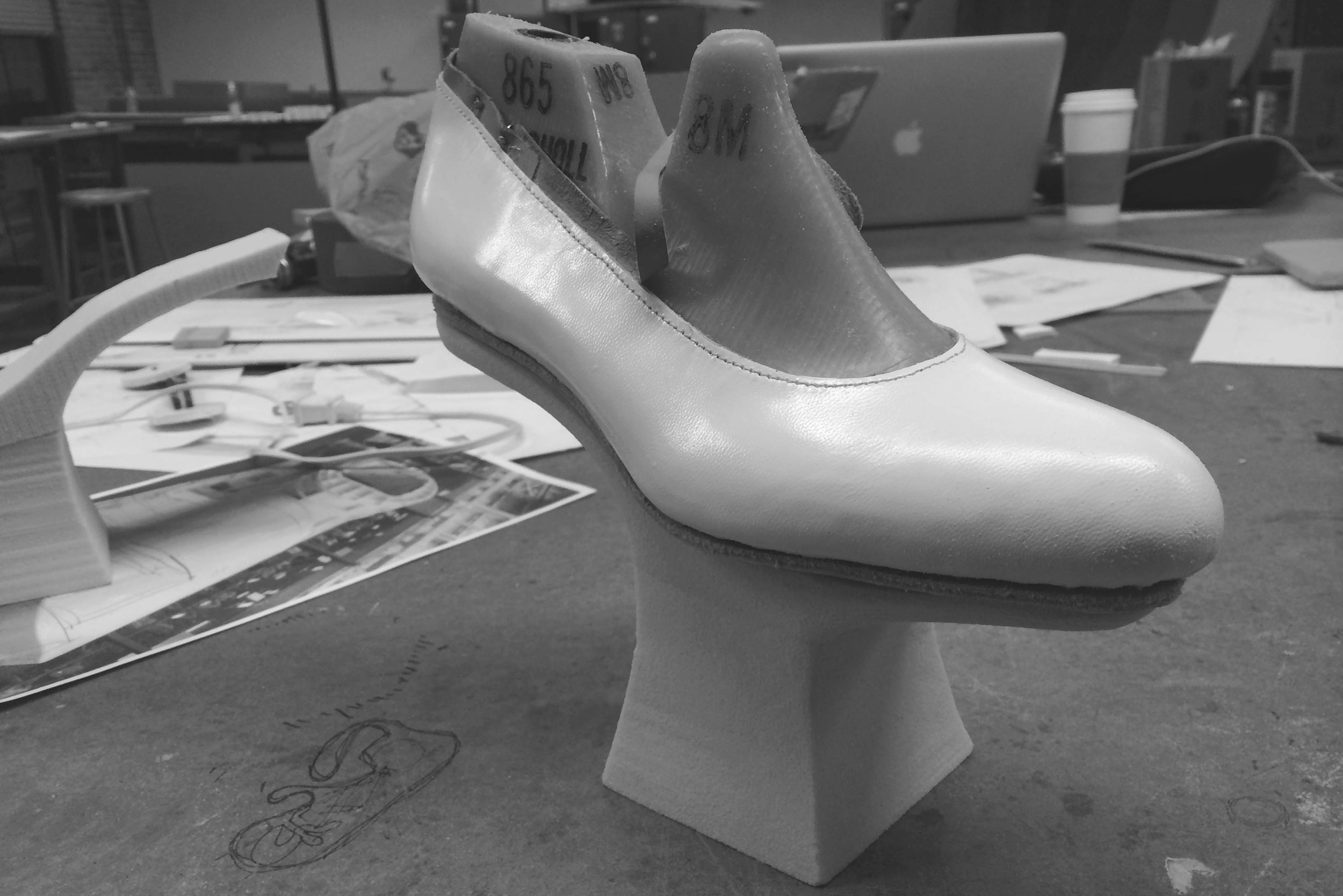 Carving the heel out of yellow foam
