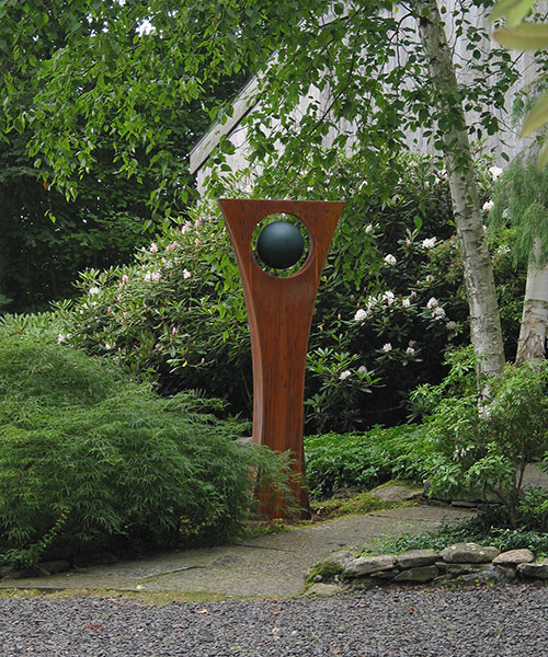 "Rise  6'7"" H x 1'11"" W x 1'11"" D cor-ten steel with painted steel ball"
