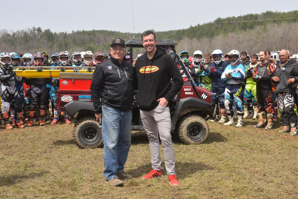 Racer Productions Director, Tim Cotter and Kurt Caselli Foundation President, Donny Emler Jr. with the new safety vehicle with pro riders at the FMF Steele Creek GNCC.  Photo: Ken Hill