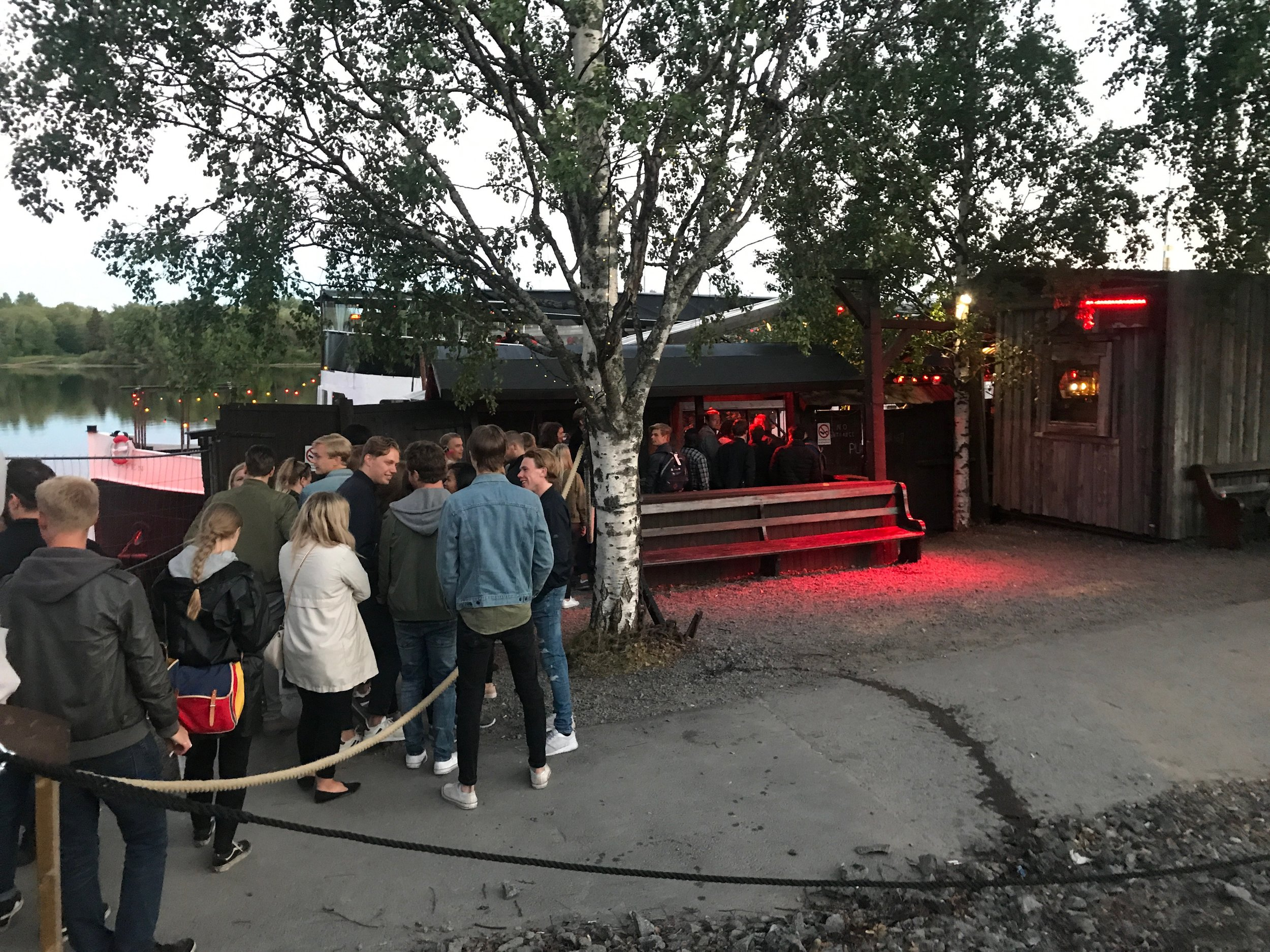 """In line for """"The Boat"""" (Pirate ship bar?Modern Valhalla? All of the above?) Typical midnight in Umeå."""