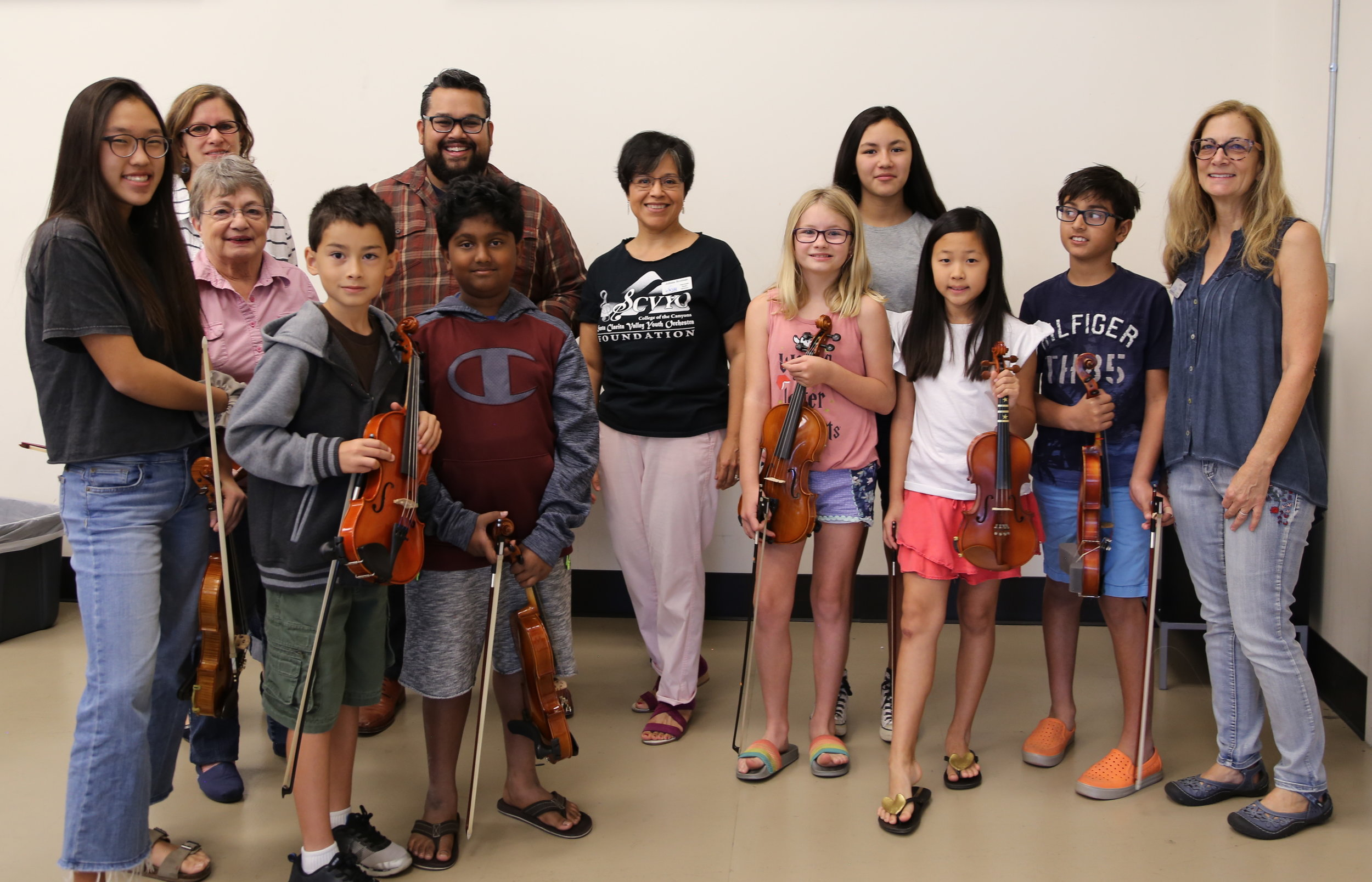 Vijay Gupta, LA Philharmonic Violinist with Julissa Bozman, SCVYO Associated Artistic Director and members of Prelude Strings
