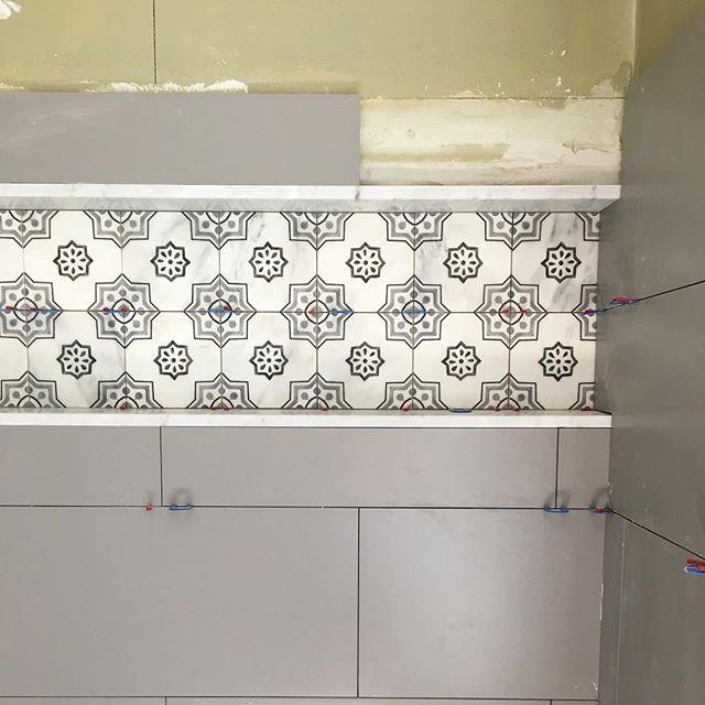 Linear shampoo niche tile install underway #sitevisit #progresspics