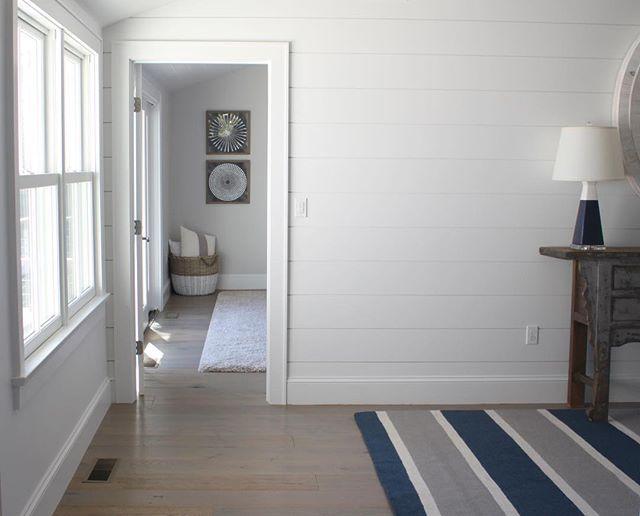 A peak into the bedroom @westelm art, @barrier_island_rugs, @bungalow5 lamp #shiplapwalls #simpledesign #midcenturyremodel #mywestelm
