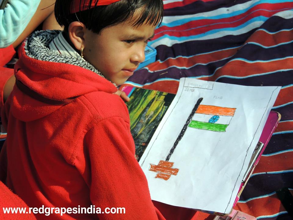 Indian flag drawn by kid on 26th Jan Republic day celebration at Wine information center by Red Grapes at Wine park, Vinchur, Nashik, Maharashtra, India