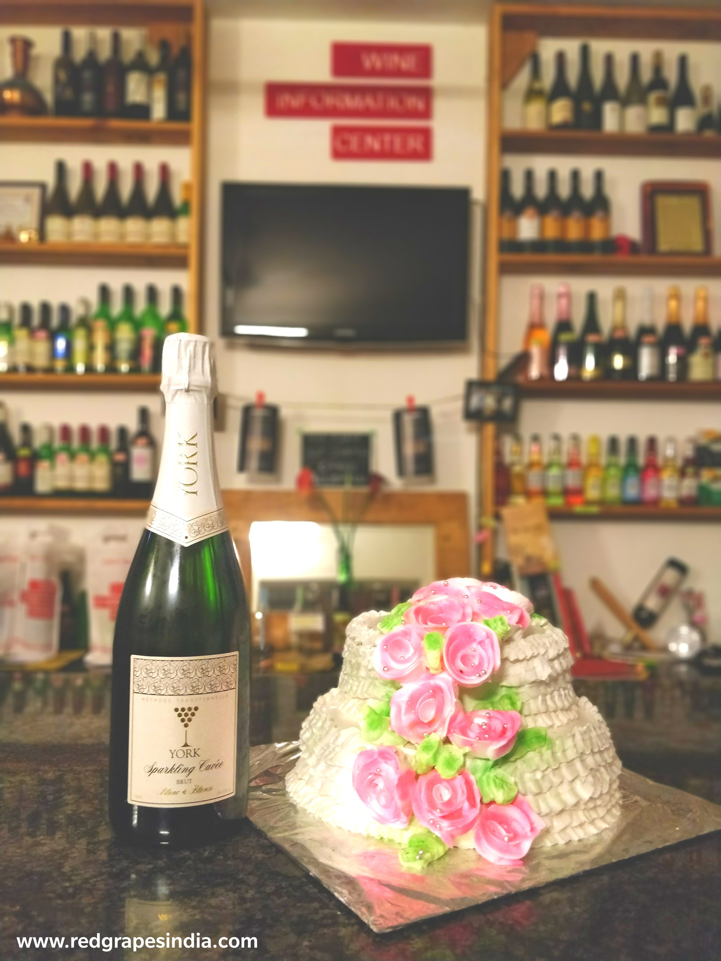 York sparkling brut wine and white cake for christmas event at wine information center at wine park