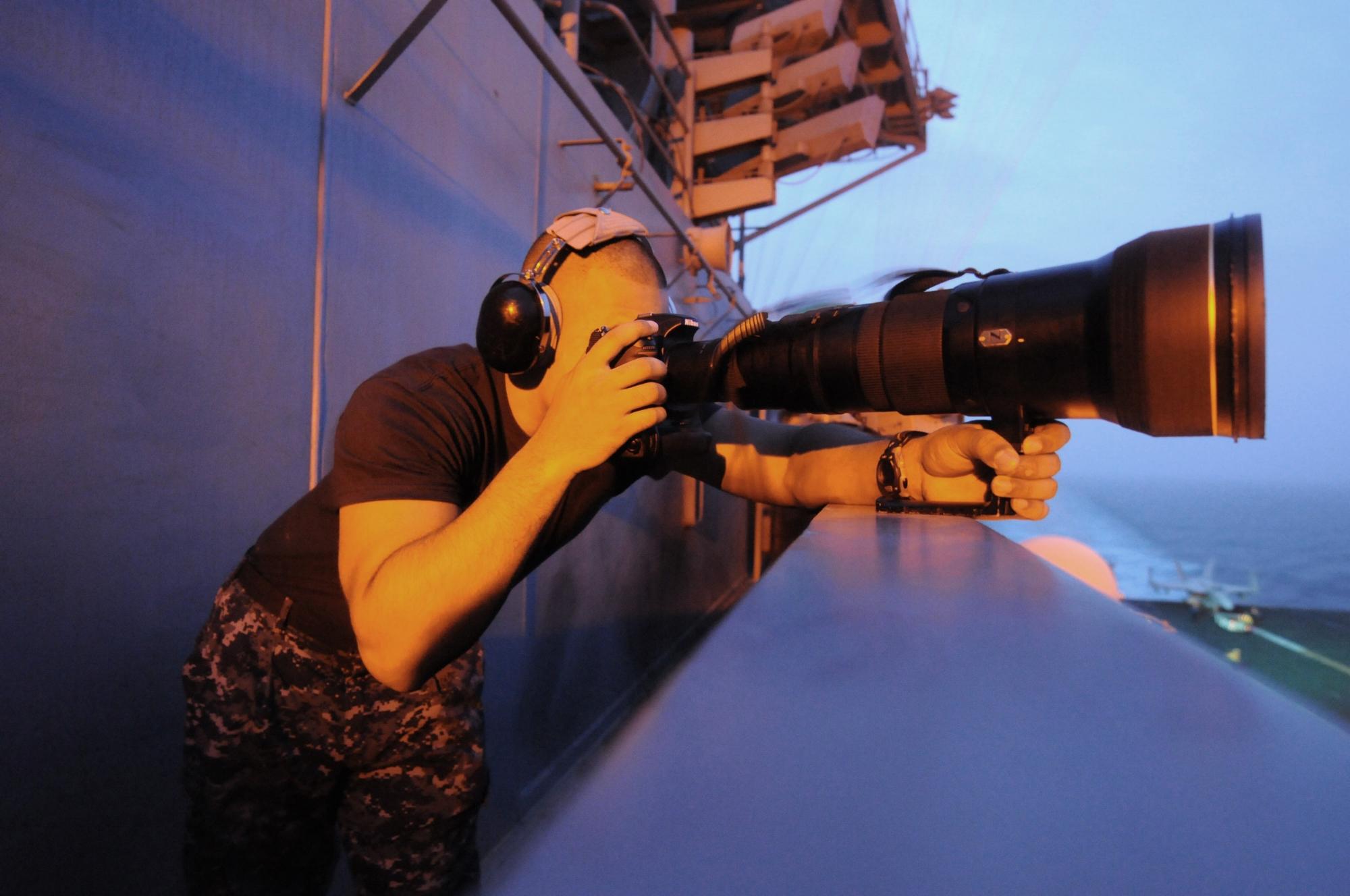 US_Navy_110724-N-WH671-103_Mass_Communication_Specialist_Seaman_Apprentice_Brian_M._Read_Castillo_takes_intelligence_photographs_aboard_USS_George.jpg