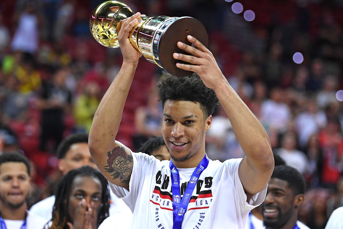 Brandon Clarke  hoists the 2019 Summer League Most Valuable Player award during the Memphis Grizzlies' championship celebration in Las Vegas. Clarke almost averaged a double-double during his time at Summer League.