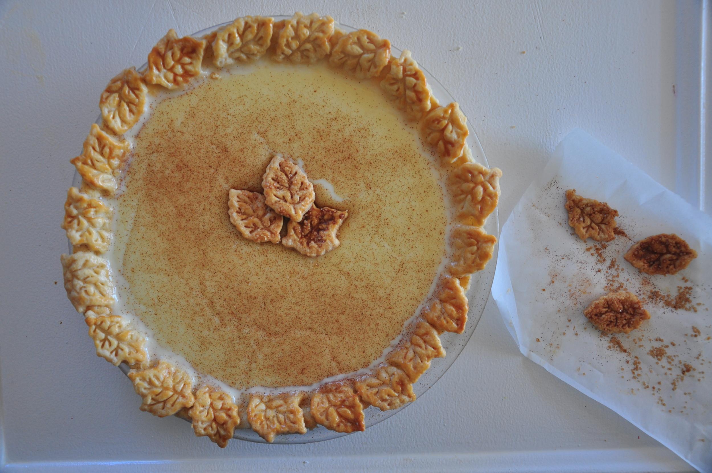 Milk Tart  in a leaf cut out pie crust.