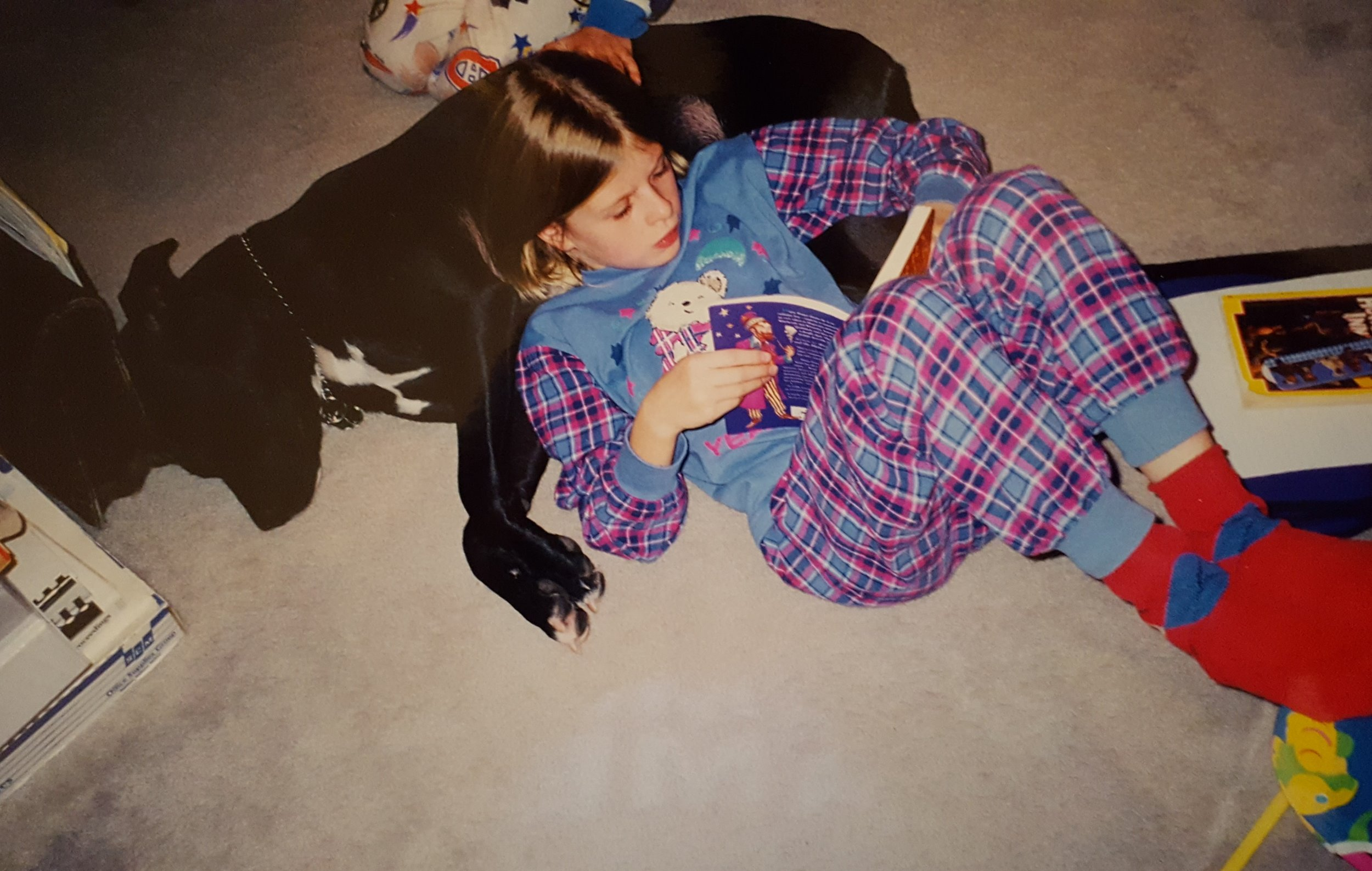 Circa 1999. Yes, I'm reading Harry Potter. Yes, my dog is my pillow. And yes, I know my socks don't match my pyjamas.