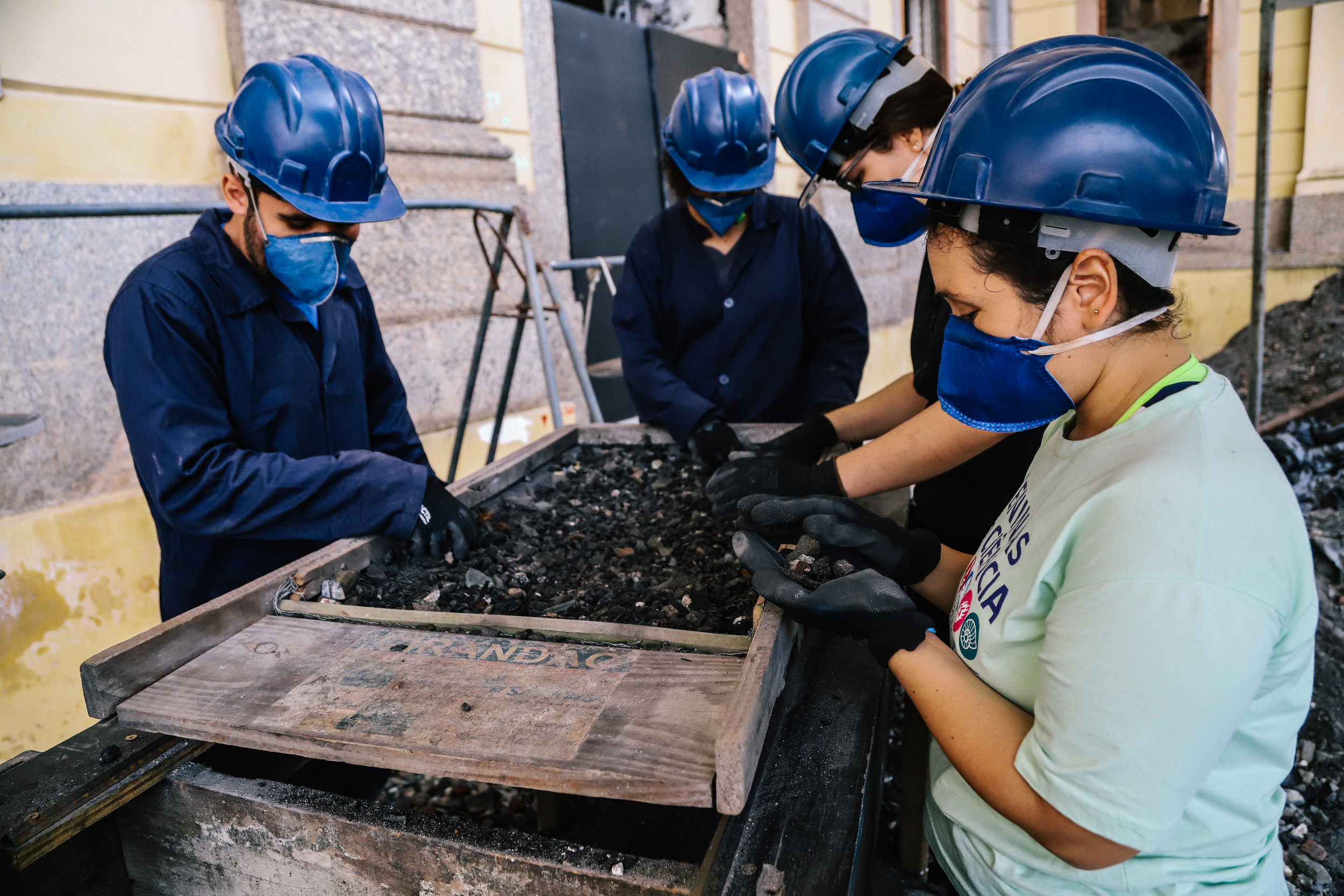 Graduate student volunteers sift through rubble from inside the museum. Students were eager to offer help after the fire, so a formal course was created to facilitate student support in the recovery effort in the months following the fire.