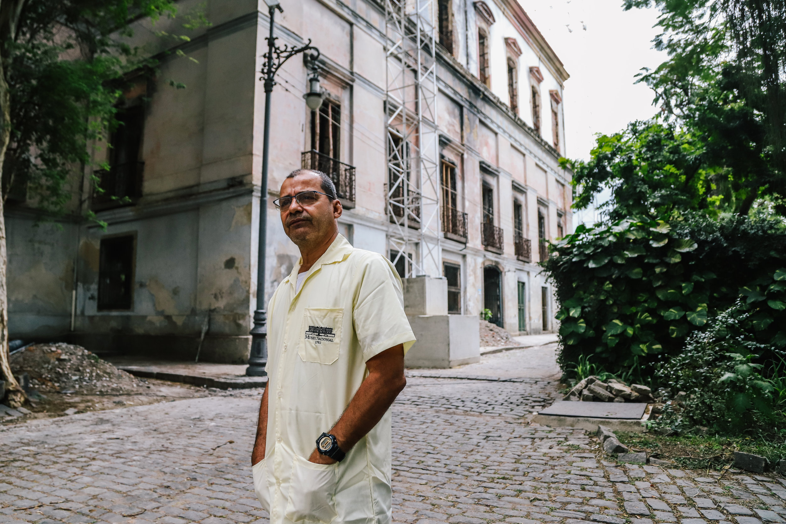 "Zoologist Claudio José Fernandes, pauses to observe the Museum. ""My father would bring me here when I was a kid"", he says, ""what was lost is irreplaceable""."