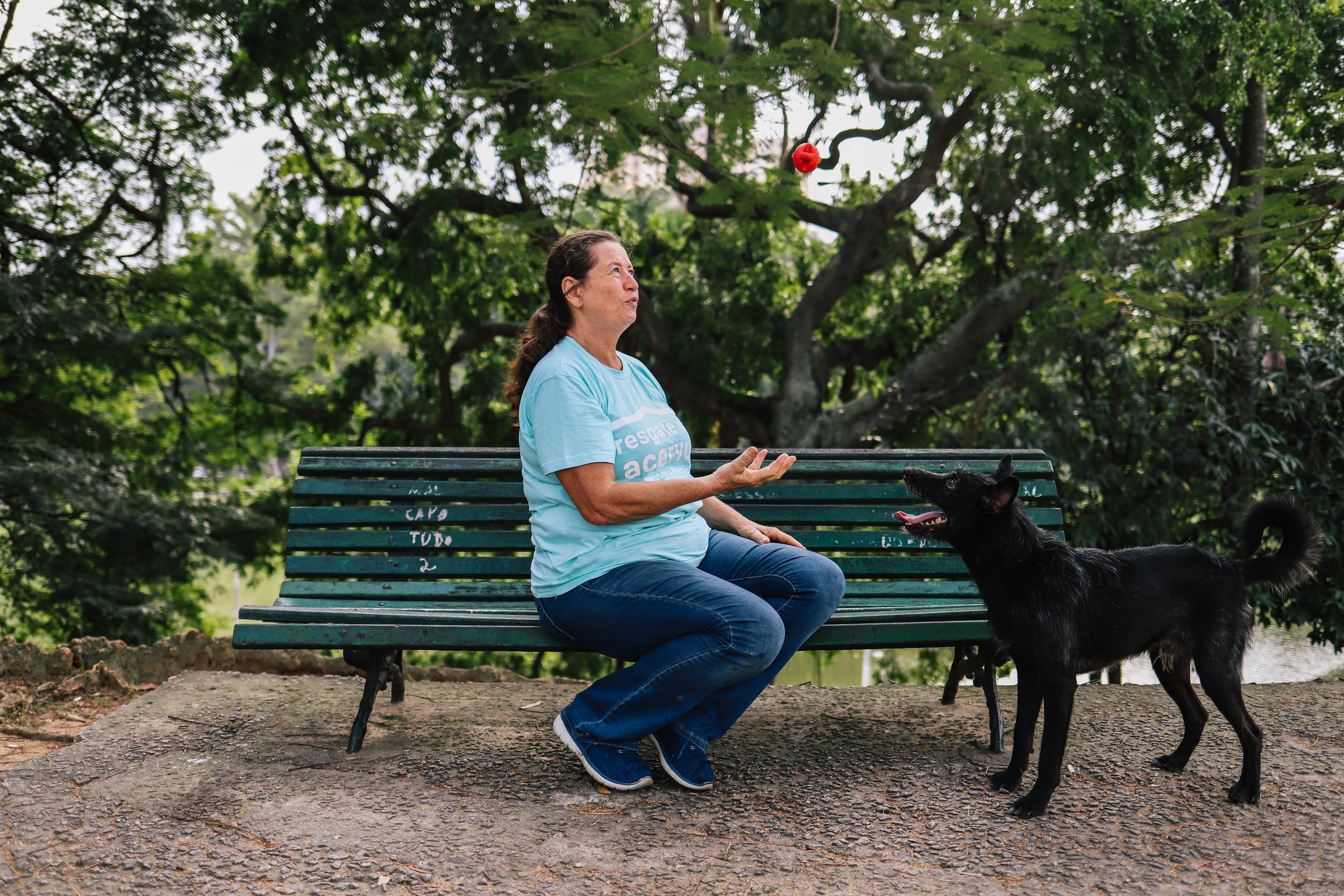 "Elizabeth Zucolotto plays with her dog, Fumaça, in Quinta da Boa Vista Park, in front of the Museum. Fumaça appeared during the fire, she says, ""he became the Museum's mascot""."