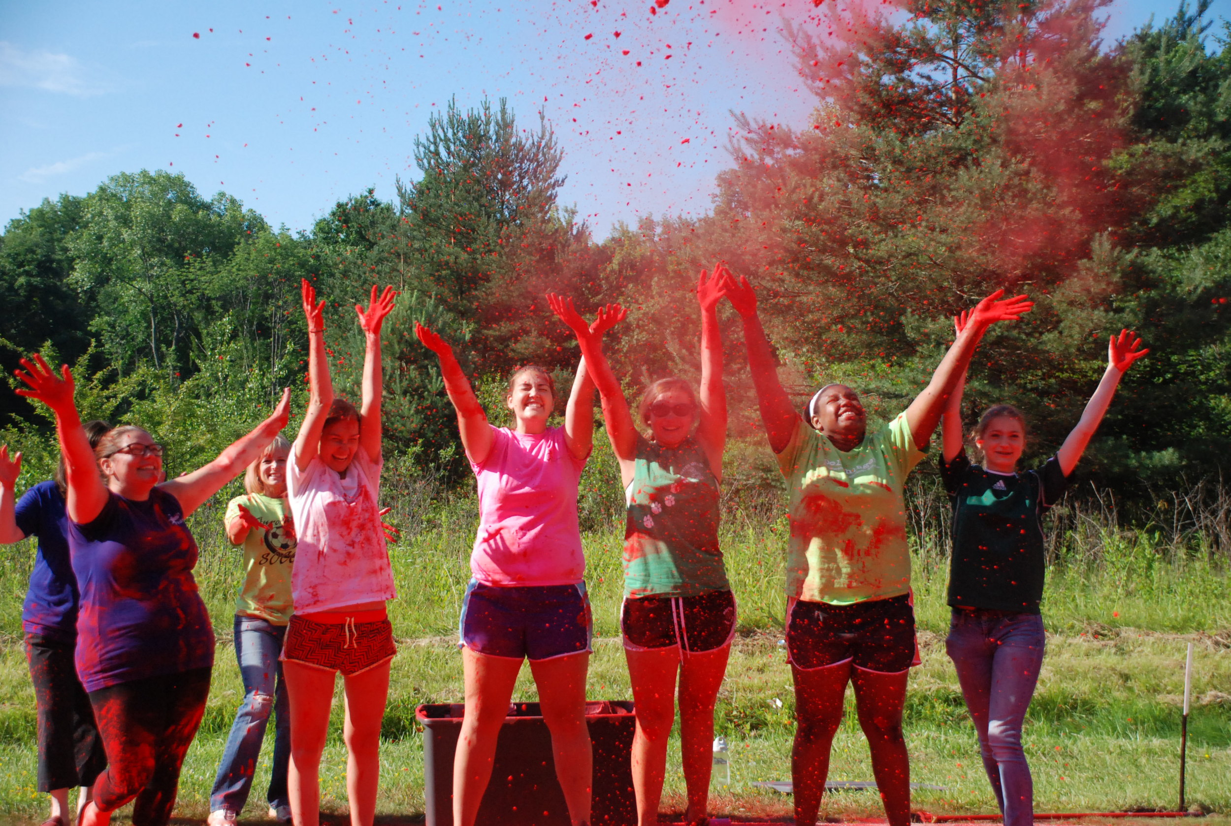 Our volunteers always have a great time! whether its color throwing (shown above), registration or being a water stop helper, they always have a smile on their face!