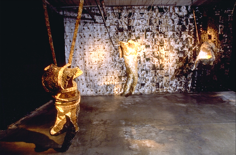 """""""Radiation Formation of a Non-volatile Comet Crust"""" , 13' x 15' x 9', Science papers, fake fur, glues, burning, audio system; 1999"""