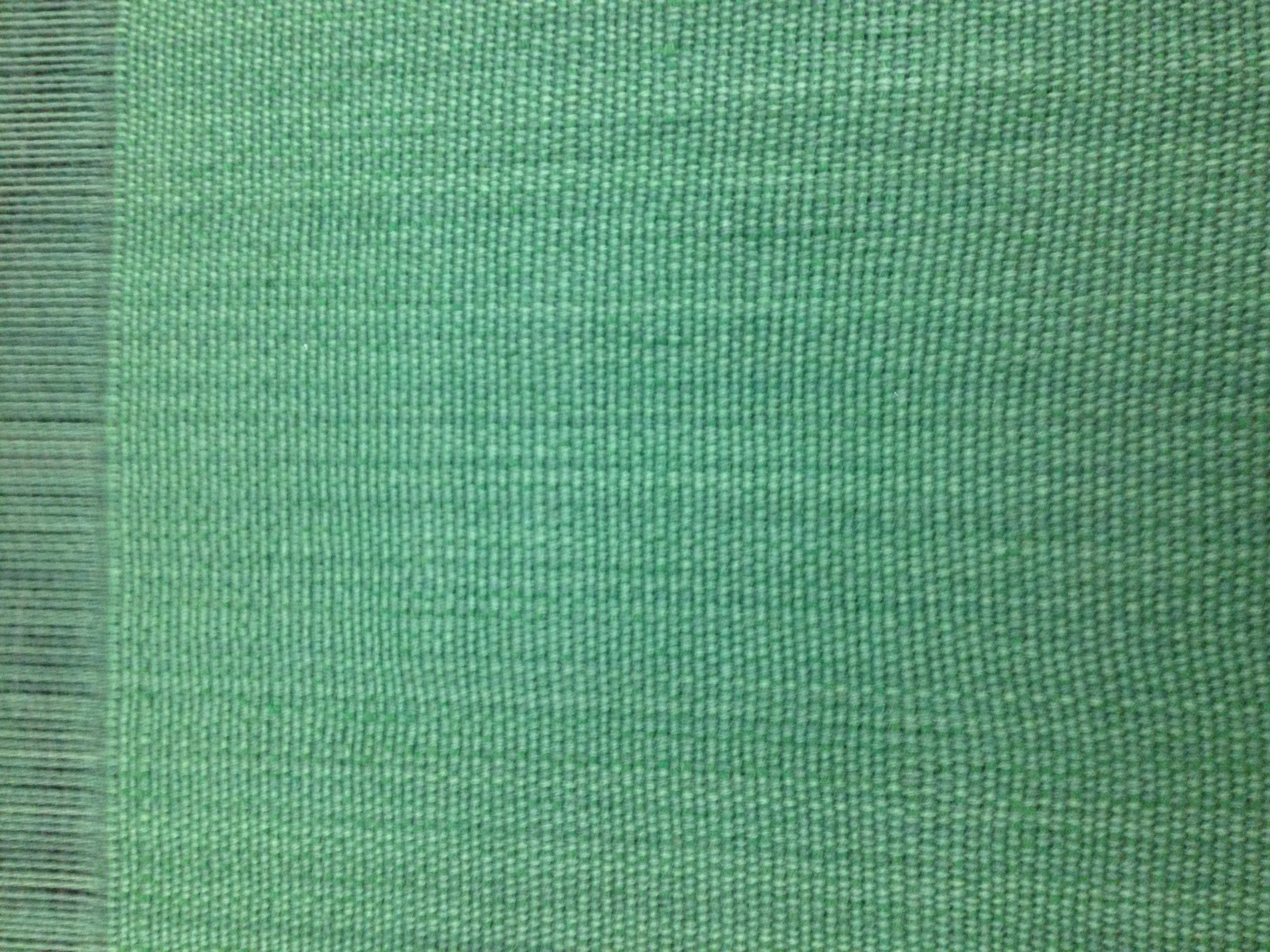 High quality close up of the fabric for Domestic Sofa In Green Handwoven Fabric