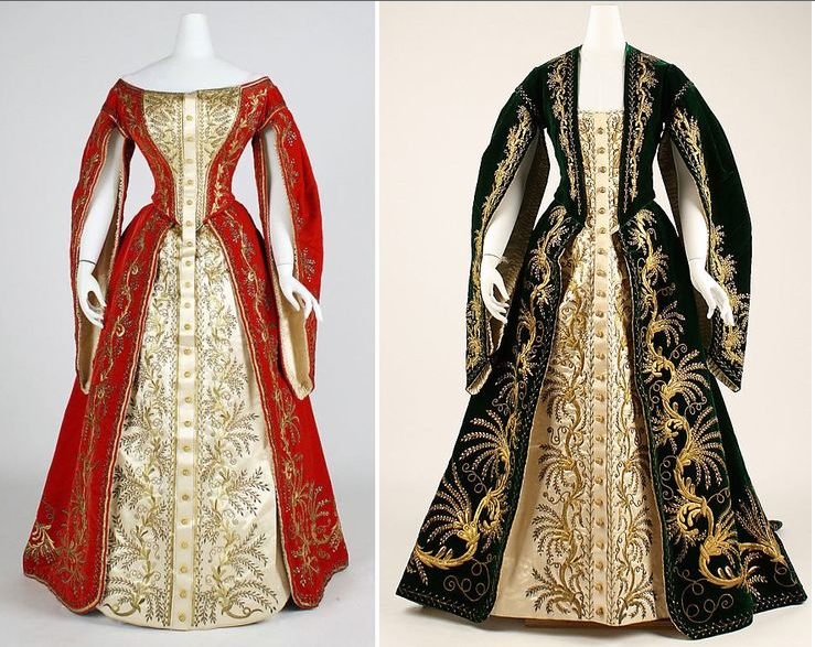 Costumes of the Ladies-In-Waiting to the Imperial Family. That of a Frelina is to the left in garnet red, and that of a Maid of Honor is to the right in Dark Green. These colors echoes the military uniforms of the Gentlemen of the Court.