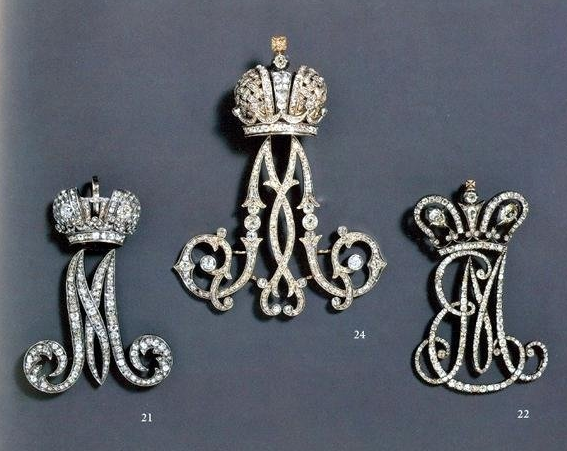 """A selection of diamond """"Chiffres"""" of the Empress. From left, that of Empress Maria Alexandrovna, wife of Alexander II, center, that of Maria Feodorovna, wife of Alexander III, and at right, that of the Empresses Elizabeth Alexeievna wife of Alexander I and Maria Feodorovna, wife of Paul I. Conjoined initials were used when there were two living empresses."""